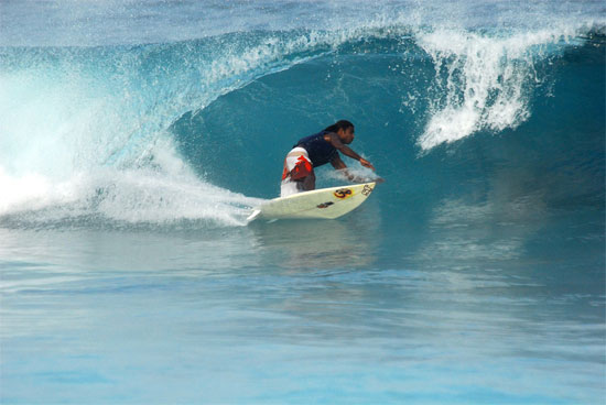 The Maldives surfer surfing