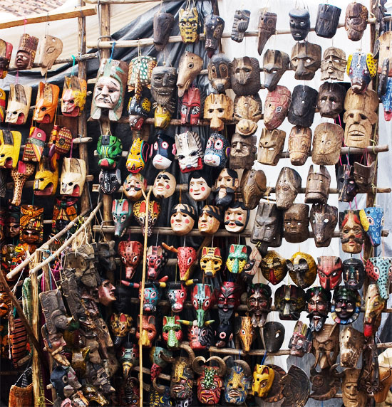 masks for sale at a market in antigua, guatemala
