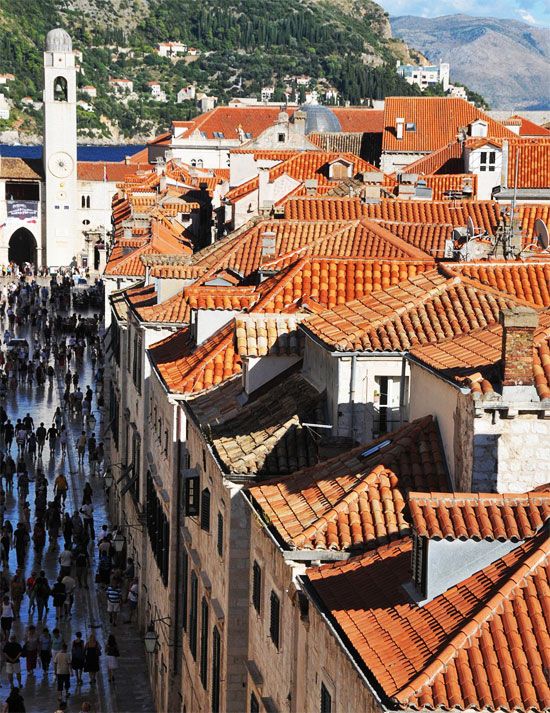 travel photo Dubrovnik Croatia bright tile rooftops bell tower busy Stradun