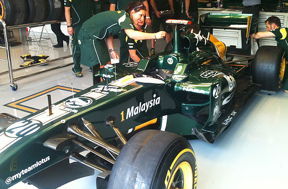 team lotus paddock team car